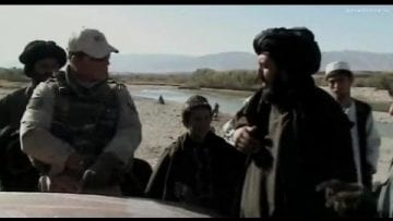 Afghan people and Dutch soldiers at Uruzgan checkpoint